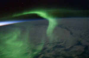 a-green-aurora-dances-over-the-night-side-of-the-earth-as-seen-from-the-international-space-station-in-2003-earth-jupiter-and-saturn-all-have-dazzling-auroras